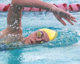 Swim team training hard to meet rivals and qualify for state